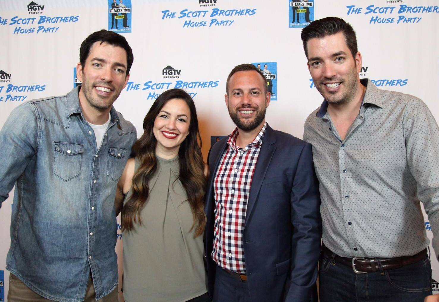 Three men and one woman smiling in front of HGTV The Scott Brothers House Party logo