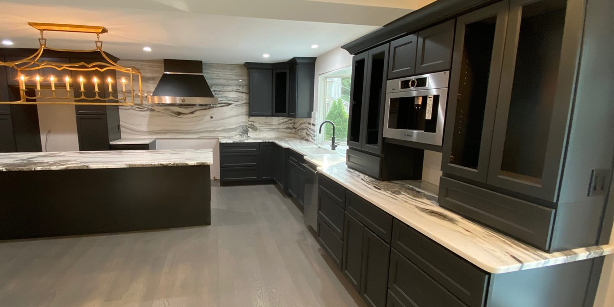black and white/grey marble kitchen with light grey wood floor