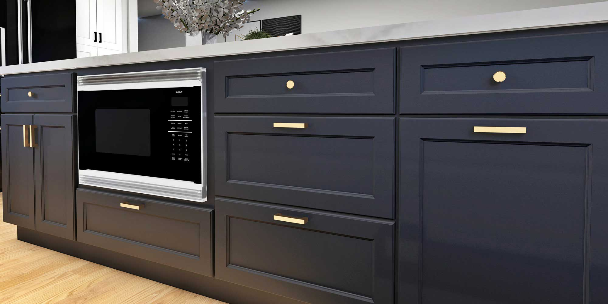 Charcoal kitchen cabinets with silver and black microwave and grey marble countertop