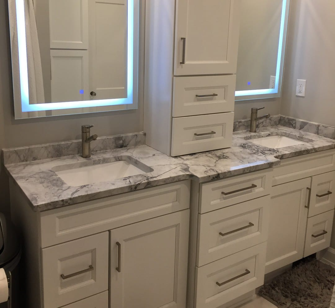 Two sinks full view of white cabinets under two mirrors with square lights and grey rug
