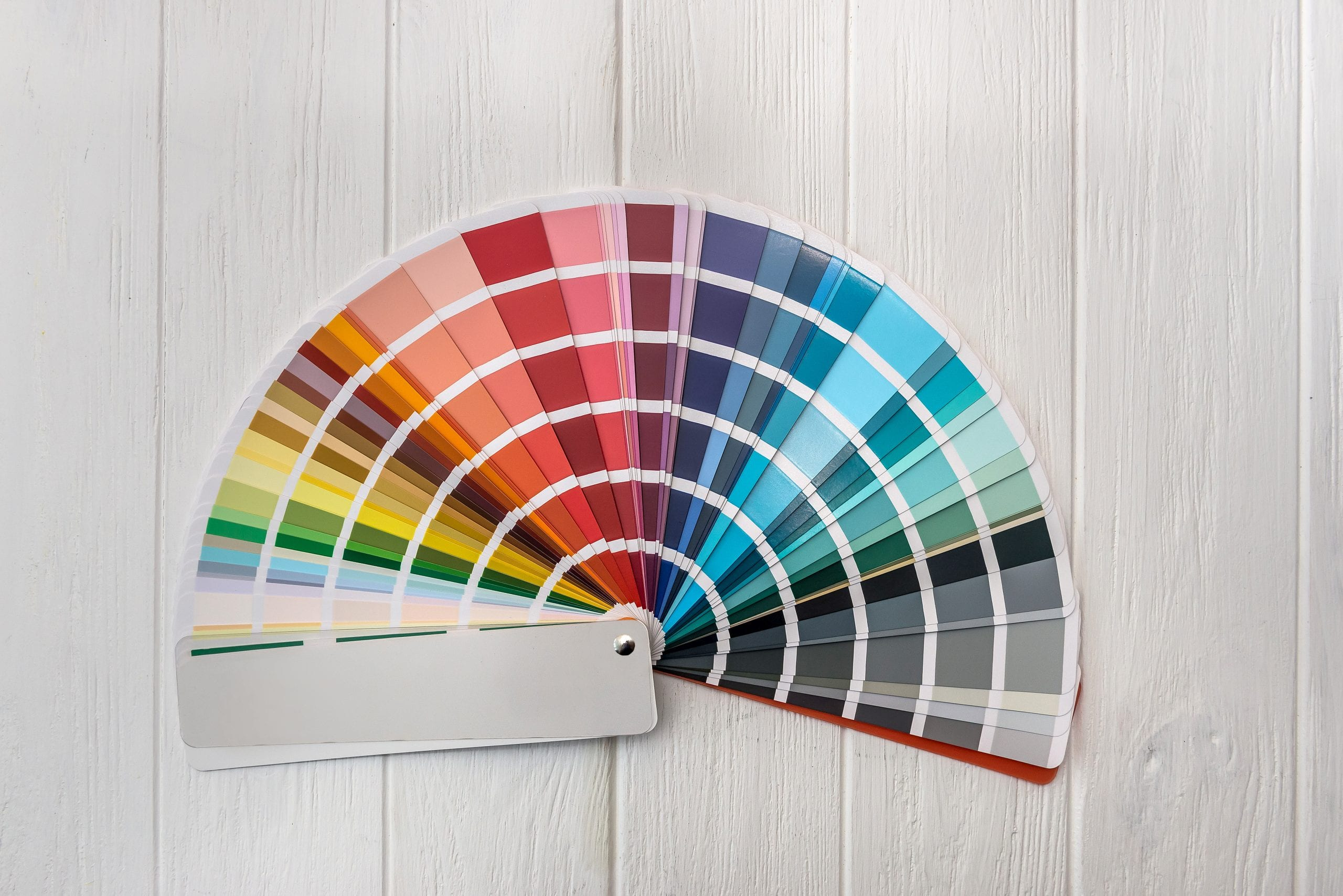 Colorful palette for wall painting on wooden desk