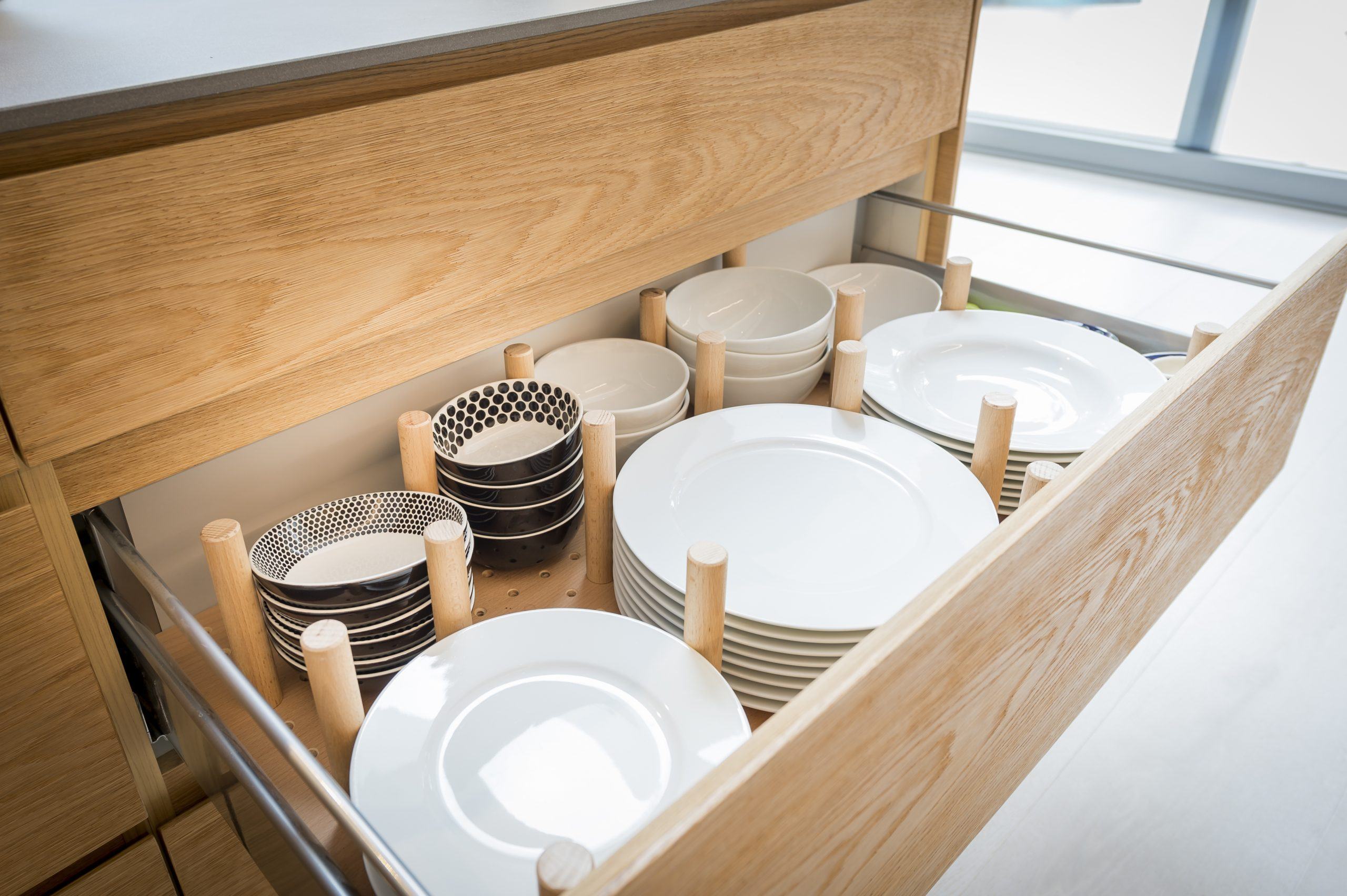 Kitchen cupboard with opened drawer organizer