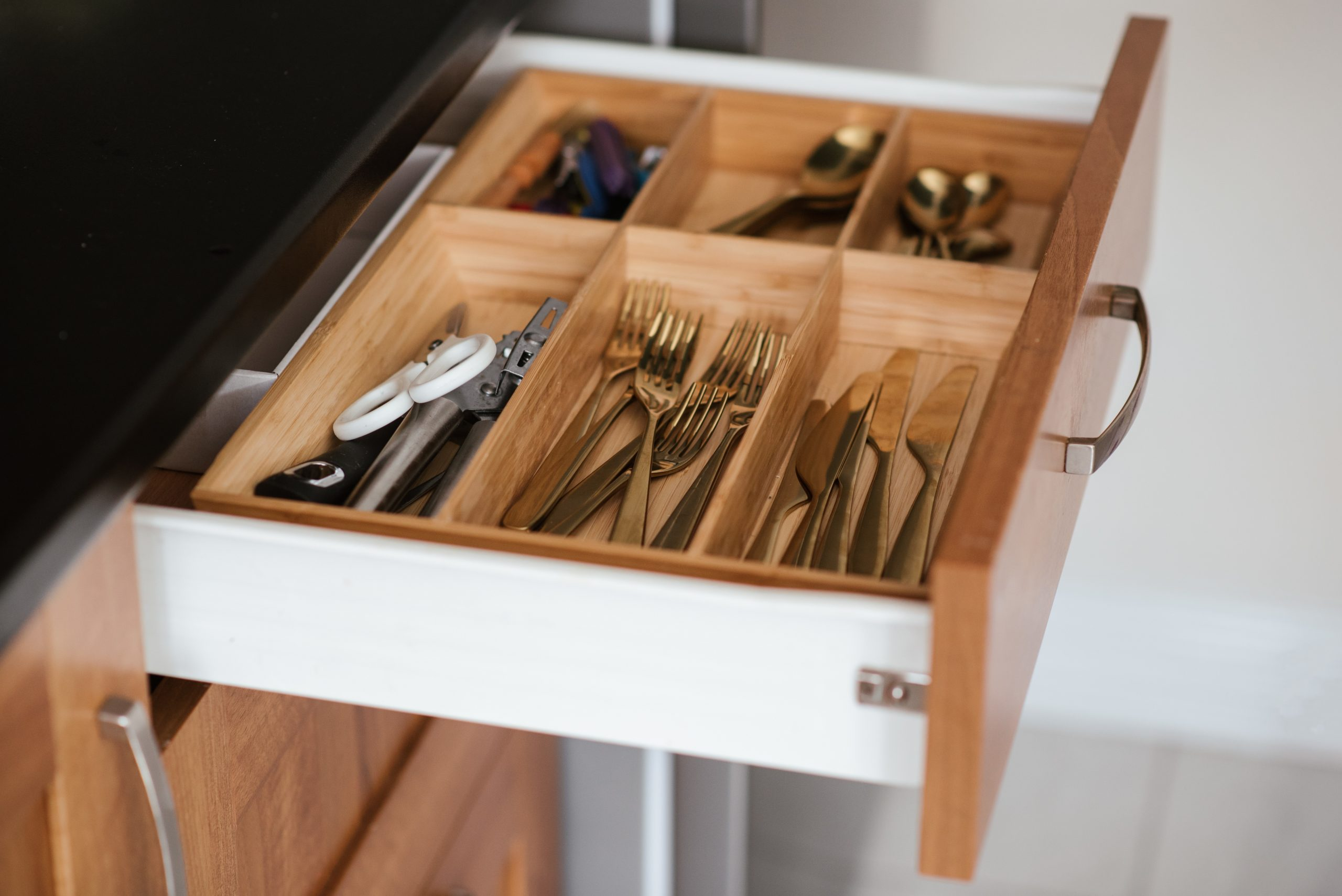 Different types of silverware in a drawer