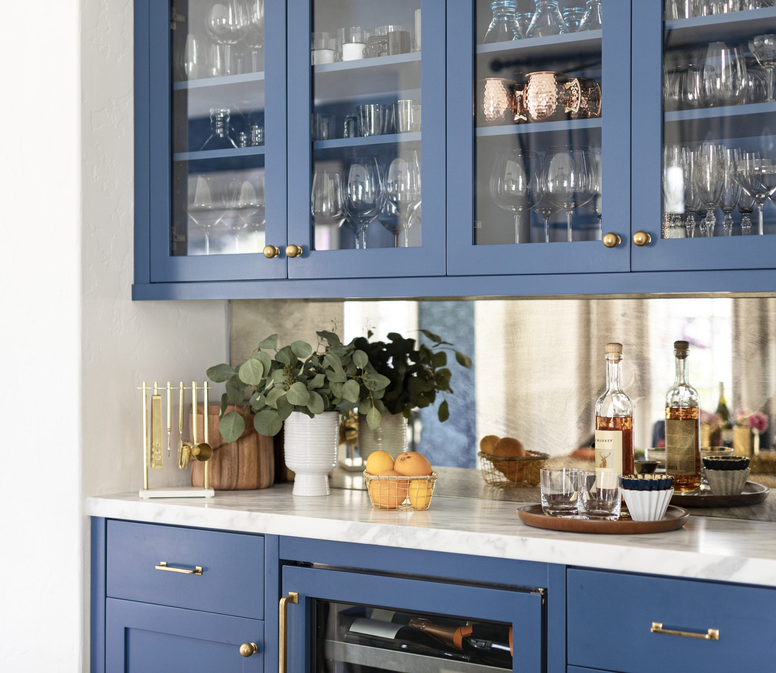Kitchen cabinets with glass doors showing dishes