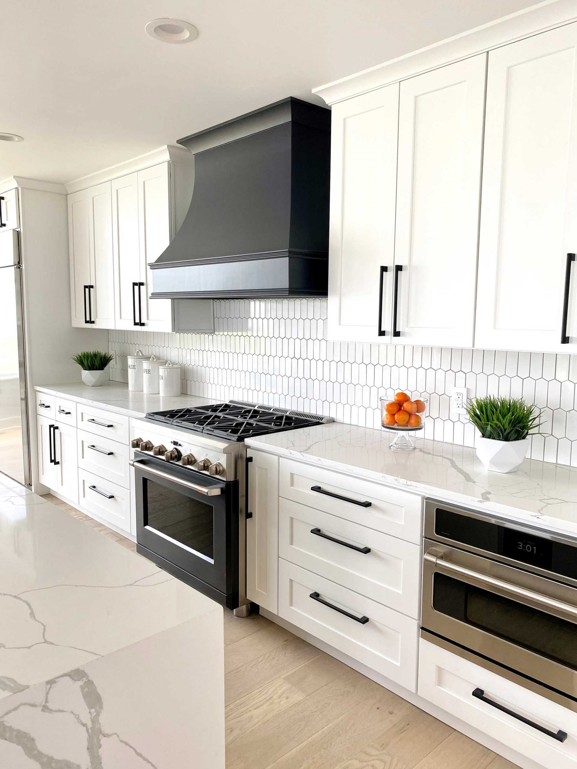 White Cabinets with Black hardware installed in kitchen by Cleveland Cabinets