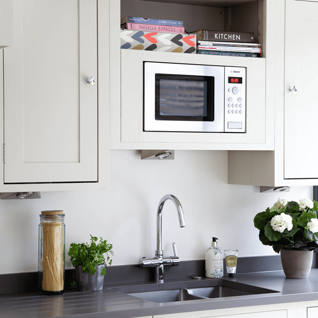 built in microwave oven for countertop space, cabinetry style, and cooking appliances