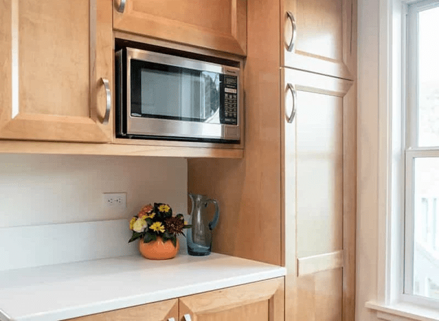 Counter microwave cabinet above the stove for homes or wall oven places