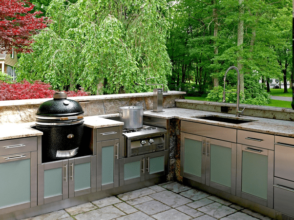 list of a kitchen island and amazing kitchen appliances like a fire pit and mini fridge, grill space, and picnic table