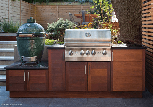 Wooden outdoor kitchen cabinet and beautiful dining area