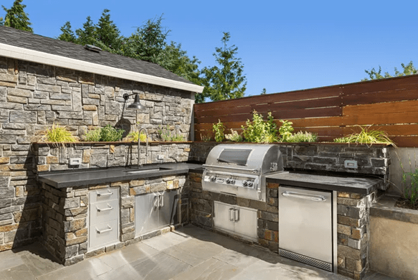 Spaces like the outdoor kitchen are beautiful, it has a pizza oven