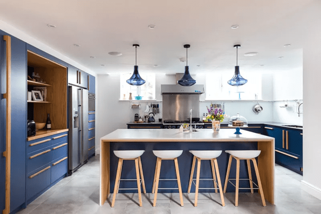 Blue Kitchen cabinets that look fully airy and light with wooden tone