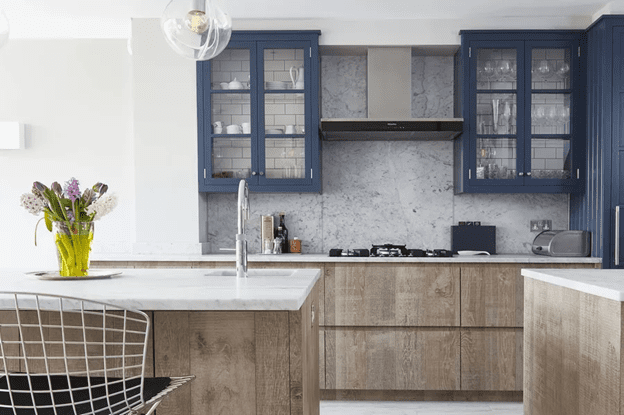 Dark blue cabinets with a rusty pop of color.
