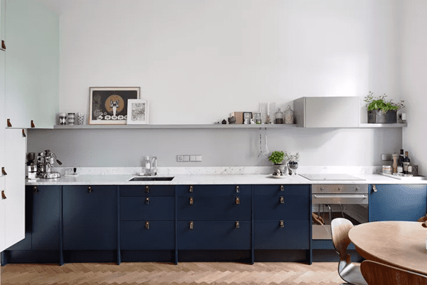 Lower cabinets of Blue Kitchens are amazing with wood and white marble tile.