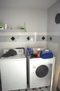 Laundry room before décor and washer and cleaning floor tiles