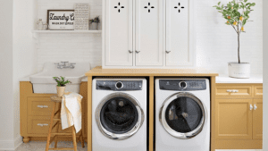 Laundry room with appliances in light brown cabinets