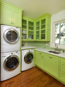 Laundry room ideas: Green cabinets in your laundry room make a different look
