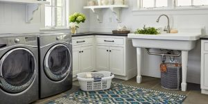 Laundry room ideas: Black washer, dryer, and white walls