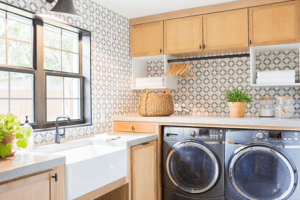 Laundry room ideas: designer make orange cabinets and pattered laundry room walls
