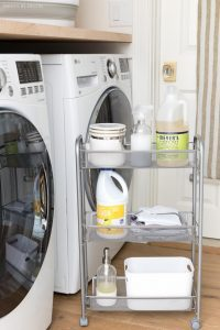 Roll-out drawer for storing detergent, household chores, and wire basket in your laundry room and white walls