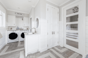 Add some flooring or cover in your laundry room and place white touch to washer dryer room