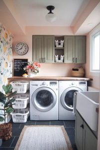Laundry room design after painting and arranged laundry baskets in a small space.
