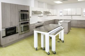Accessible kitchen design best for a wheelchair user with oven door and floor space
