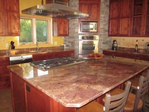 Red custom Granite countertop and hot pots in a kitchen