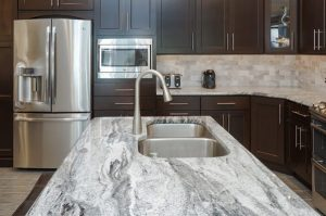 Install Silver Cloud Granite Countertop in your kitchen near sink andwall