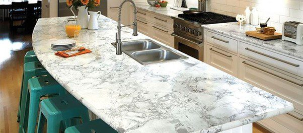 Granite countertops in kitchen with green stools