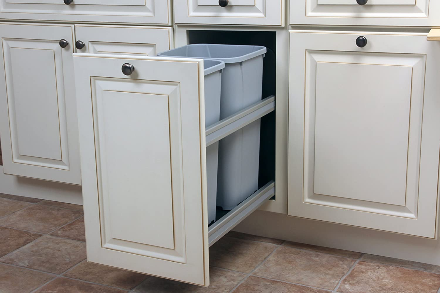 Trash can pull-out cabinet. White cabinets.